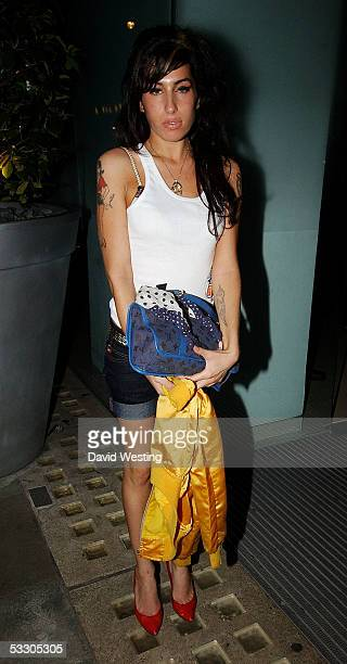 Singer Amy Winehouse attends the CoalitionTotal Communication 3rd Birthday Party at The Light Bar St Martin's Lane Hotel on July 29 2005 in London...
