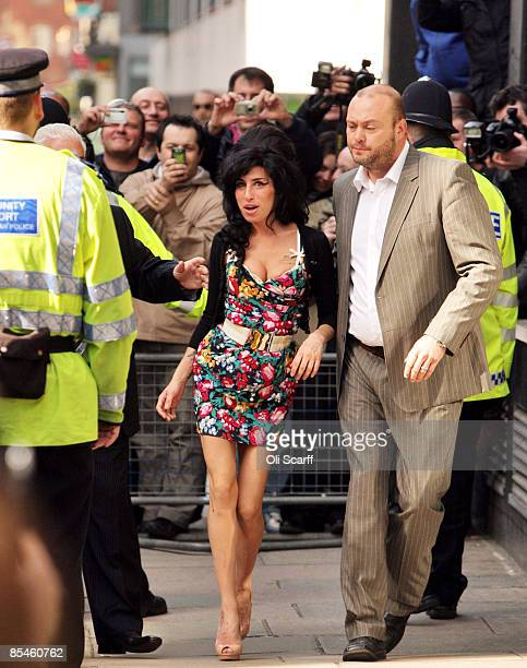 Singer Amy Winehouse attends Westminster Magistrates Court to face charges of common assault on March 17, 2009 in London, England. The soul singer is...