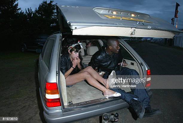 Singer Amy Winehouse drives away from the back entrance of the Bacardi B-Live VIP Area in the boot of her car with her backing singer Ade after...