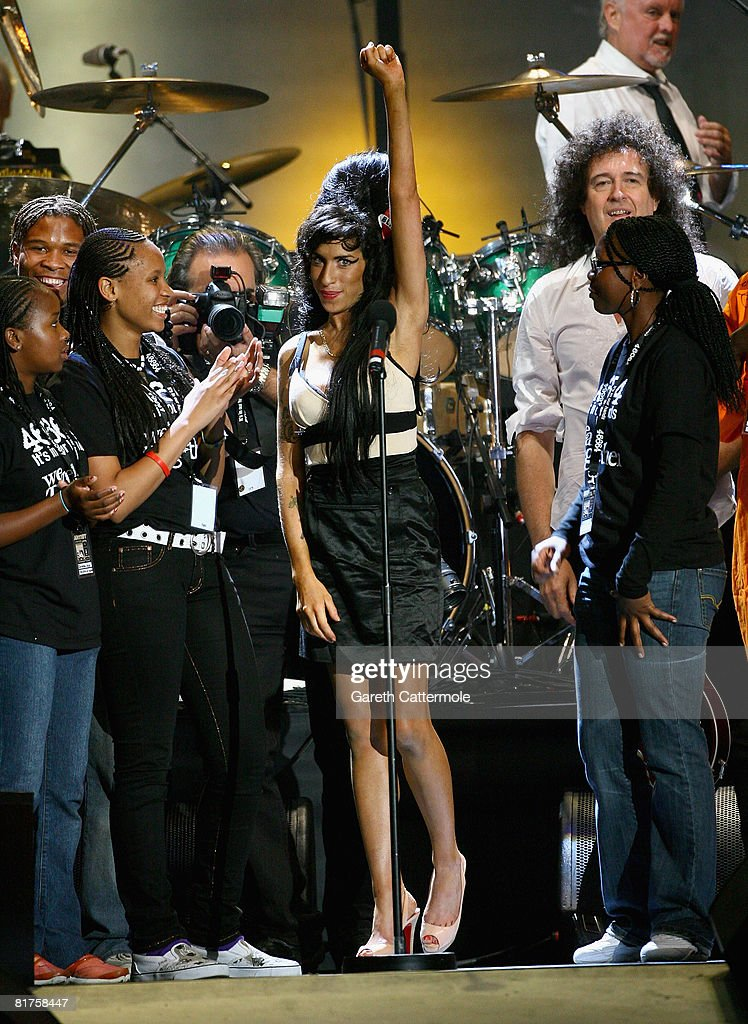 Singer Amy Winehouse onstage during the 46664 Concert In Celebration Of Nelson Mandela's Life held at Hyde Park on June 27, 2008 in London, England. Roger Taylor and Brian May of Queen are on the right.