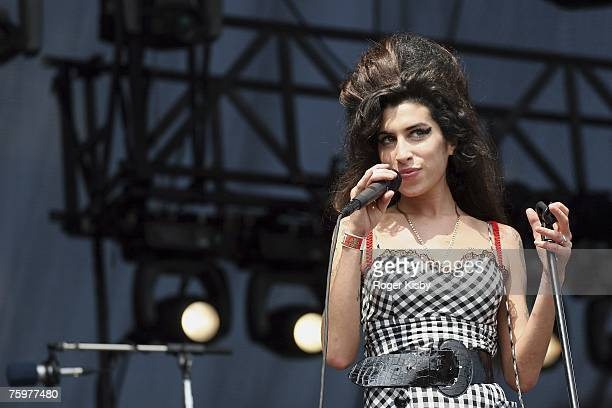 Singer Amy Winehouse performs onstage at Lollapalooza in Grant Park on August 5 2007 in Chicago Illinois