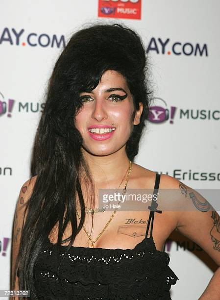 Singer Amy Winehouse poses in the Awards Room at the Q Awards 2006 held at the Grosvenor House Hotel on October 30 2006 in London England