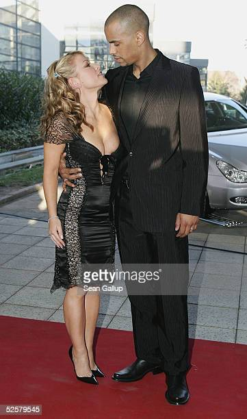 Singer Anastacia and friend Pascal Bouedibela arrive for the 'ECHO' 2005 German Music Awards at the Estrel Convention Center on April 2 2005 in...