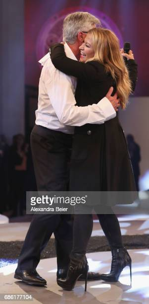 US singer Anastacia dances with FC Bayern Muenchen team coach Carlo Ancelotti during the FC Bayern Muenchen Championship party following the...