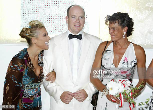 US singer Anastacia Prince Albert of Monaco and Princess Stephanie arrive 05 August 2005 to attend to the annual Red Cross Ball or Bal de la...