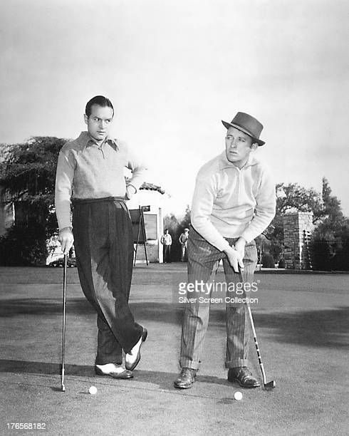 Singer and actor Bing Crosby and comedian and actor Bob Hope on a golf course circa 1940