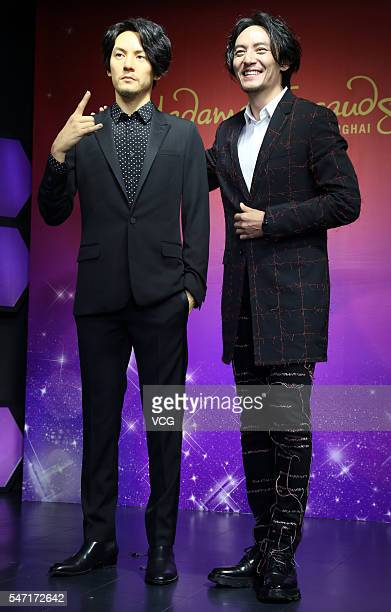 Singer and actor Chen Chang poses with his wax figure at Madame Tussauds Shanghai on July 13 2016 in Shanghai China