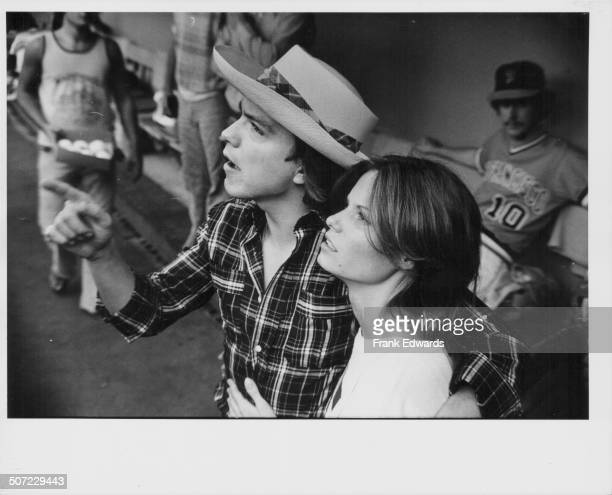 Singer and actor David Cassidy and his wife actress Kay Lenz attending the 'Happy Days' baseball game at Dodgers Stadium Los Angeles CA August 1977