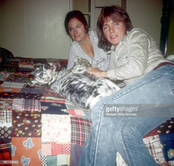 Singer and actor David Cassidy poses for a portrait with his mother Evelyn Ward and dog at home in October 1972 in Los Angeles California