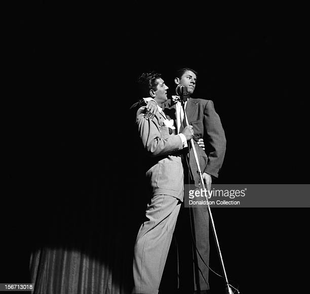 Singer and actor Dean Martin and comedian actor and director Jerry Lewis perform on stage at the Paramount Theatre in July 1951 in New York City New...