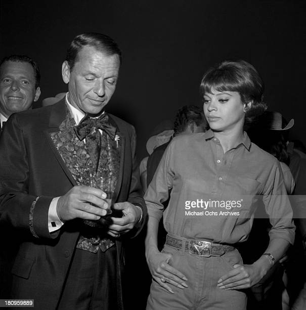 Singer and actor Frank Sinatra and fiance Juliet Prowse attend the SHARE Boomtown benefit party in 1963 in Los Angeles California