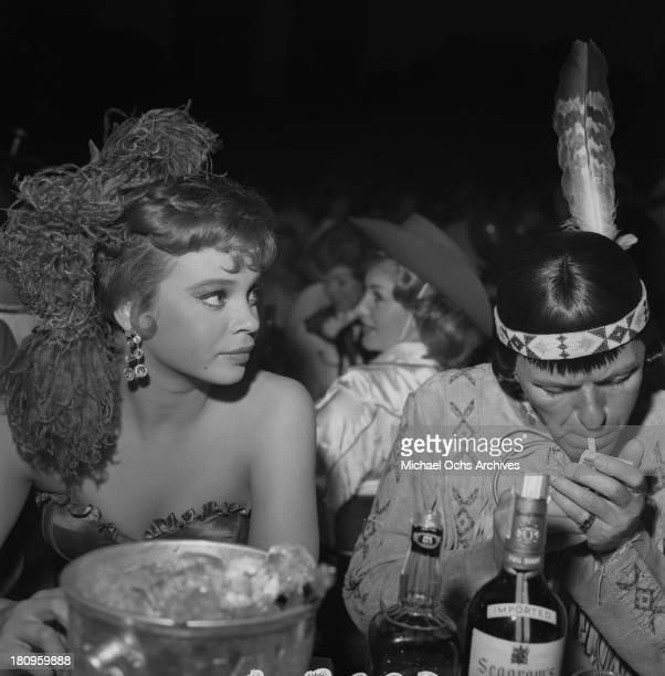 Singer and actor Frank Sinatra and girlfriend Juliet Prowse attend the SHARE Boomtown benefit party at the Moulin Rouge on May 13 1960 in Los Angeles...
