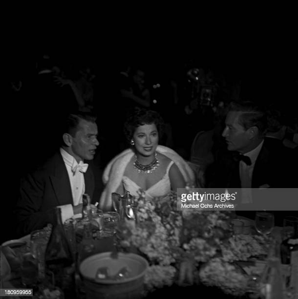 Singer and actor Frank Sinatra attends the 27th Academy Awards dinner with actress Merle Oberon on March 30 1955 in Los Angeles California
