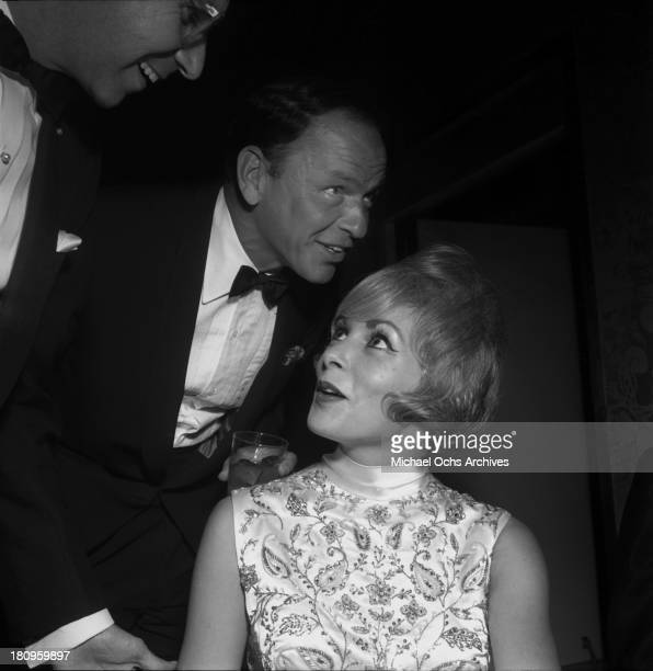Singer and actor Frank Sinatra chats with actress Janet Leigh circa 1962 in Los Angeles California