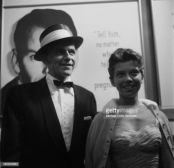 Singer and actor Frank Sinatra with daughter Nancy Sinatra attends the premiere of the film 'Not As A Stranger' on June 29, 1955 in Los Angeles,...