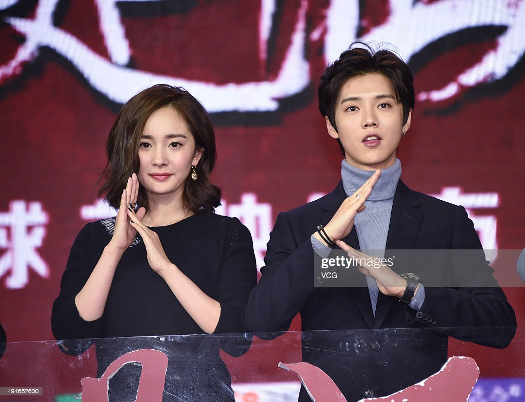 Singer and actor Lu Han, actress Yang Mi attend the press conference of film 'The Witness' on October 28, 2015 in Beijing, China.