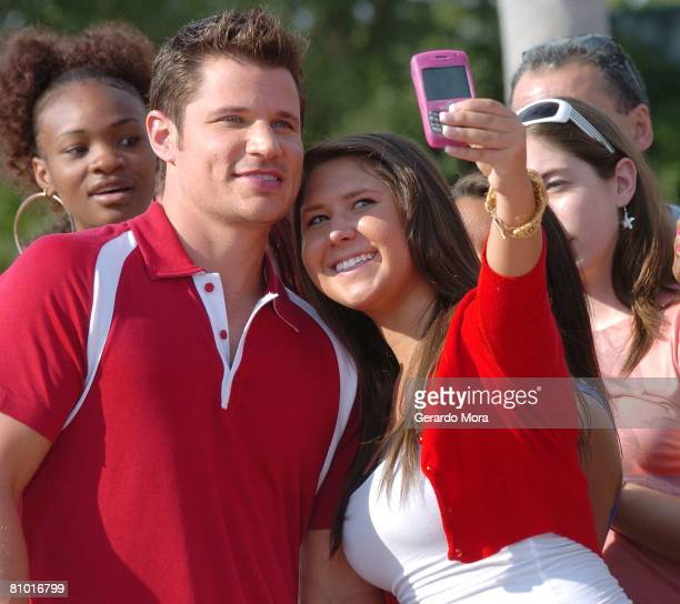 Singer and actor Nick Lachey poses for a picture with an audition paticipant during the Disney's High School Musical Get in the Picture Session...