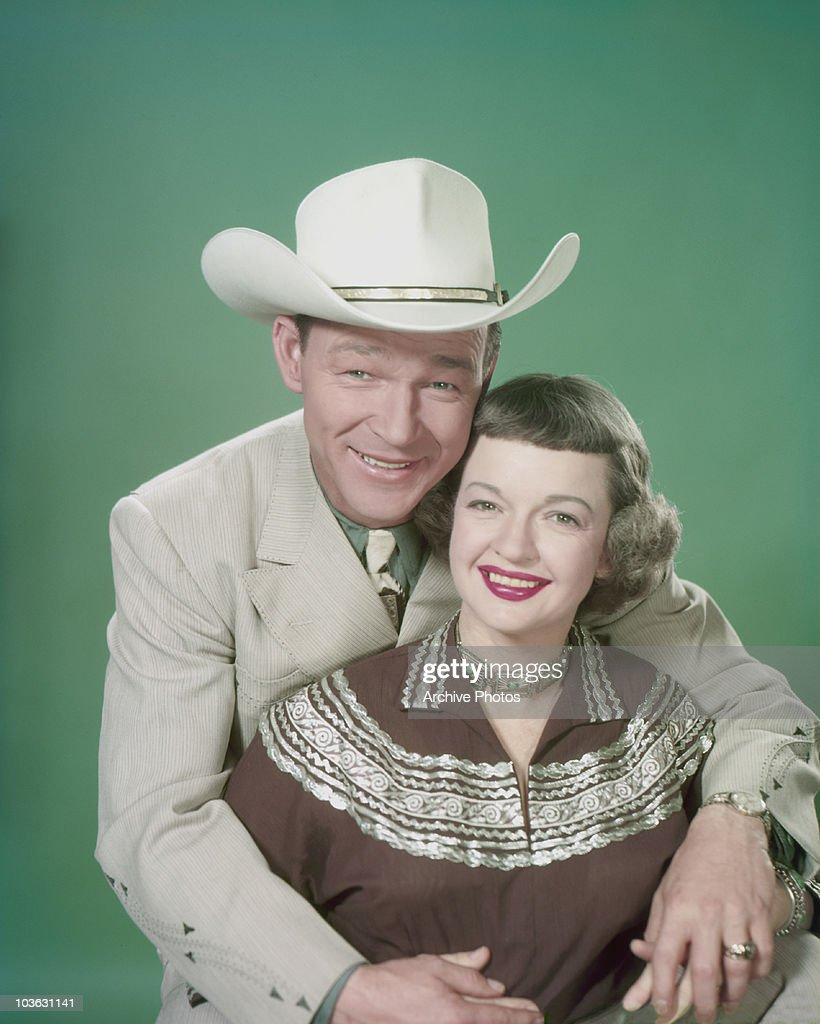 543542ca5b3 Singer and actor Roy Rogers and his wife Dale Evans pictured smiling with  Rogers seated behind