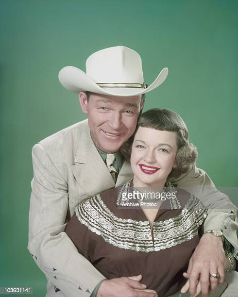 Singer and actor Roy Rogers and his wife Dale Evans pictured smiling with Rogers seated behind his wife with his arms around her USA circa 1955