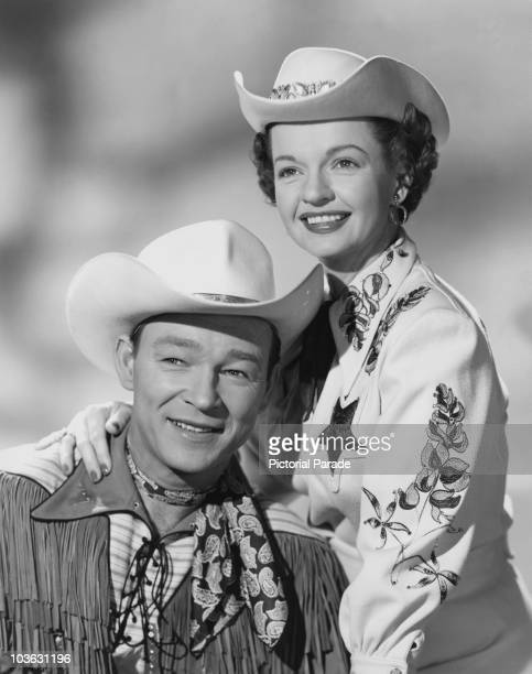 Singer and actor Roy Rogers and his wife Dale Evans pictured smiling with Evans resting her hand on Rogers' shoulder USA circa 1955 Both Rogers and...