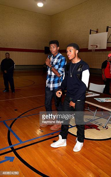 Singer and actor Trevor Jackson and rapper Diggy Simmons chat with their fans before performing their single My Girl at the Foster Park Fieldhouse on...