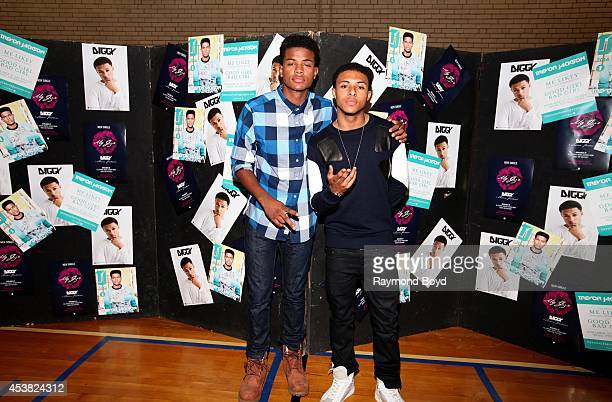 Singer and actor Trevor Jackson and rapper Diggy Simmons poses for photos at the Foster Park Fieldhouse on August 9 2014 in Chicago Illinois