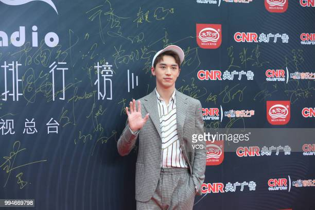 Singer and actor Xu Weizhou arrives at the red carpet of the Music Radio China Top Chart Awards Ceremony on July 6 2018 in Beijing China
