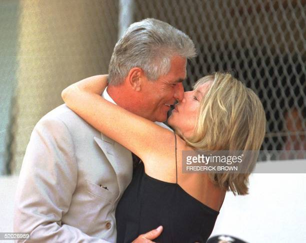 US singer and actress Barbra Streisand gives her husband actor James Brolin a kiss during his Hollywood star installation on the Walk of Fame in...