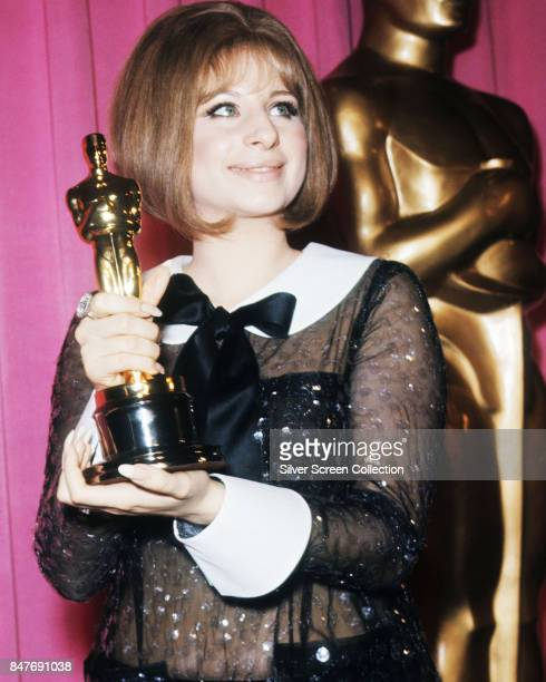 Singer and actress Barbra Streisand holds her Oscar for Best Actress won for the performance as Fanny Brice in the musical comedydrama movie Funny...
