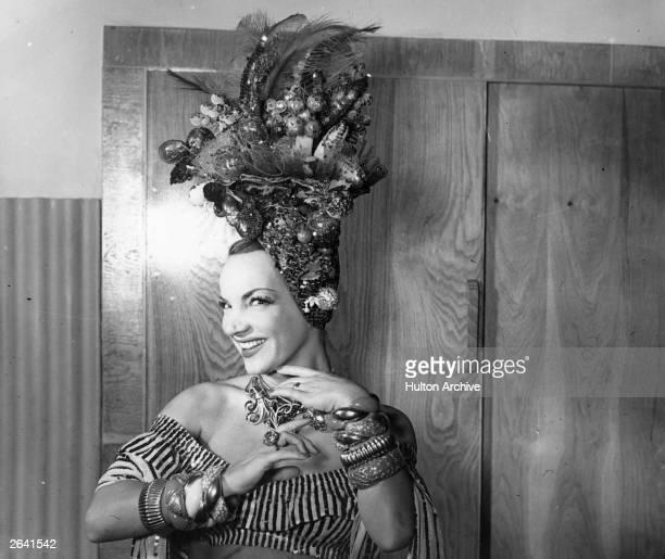 Singer and actress Carmen Miranda poses in her dressing room Original Publication People Disc HN0244