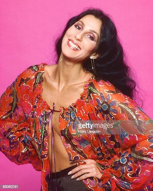 Singer and actress Cher poses for a photo session in a Bob Mackie blouse on March 21 1977 in Los Angeles California