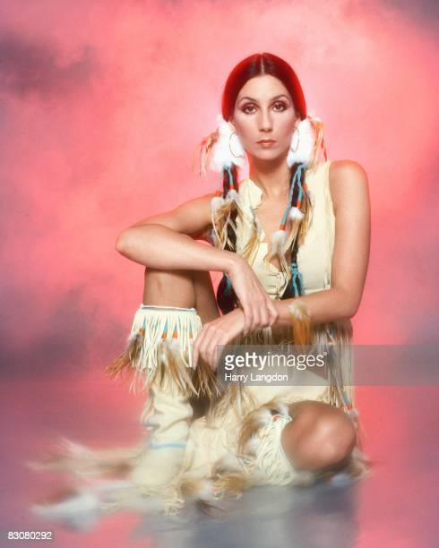 Singer and actress Cher poses for a photo session in a Bob Mackie blouse on March 21, 1977 in Los Angeles, California.