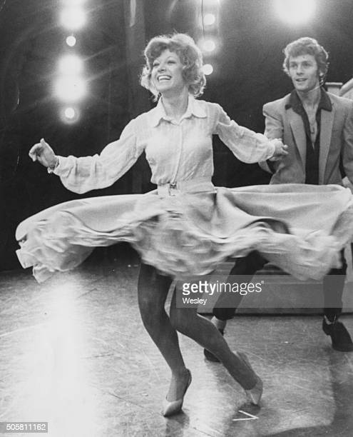 Singer and actress Elaine Paige smiling as she twirls during a dance with another actor after being announced as the lead actress in the new Andrew...