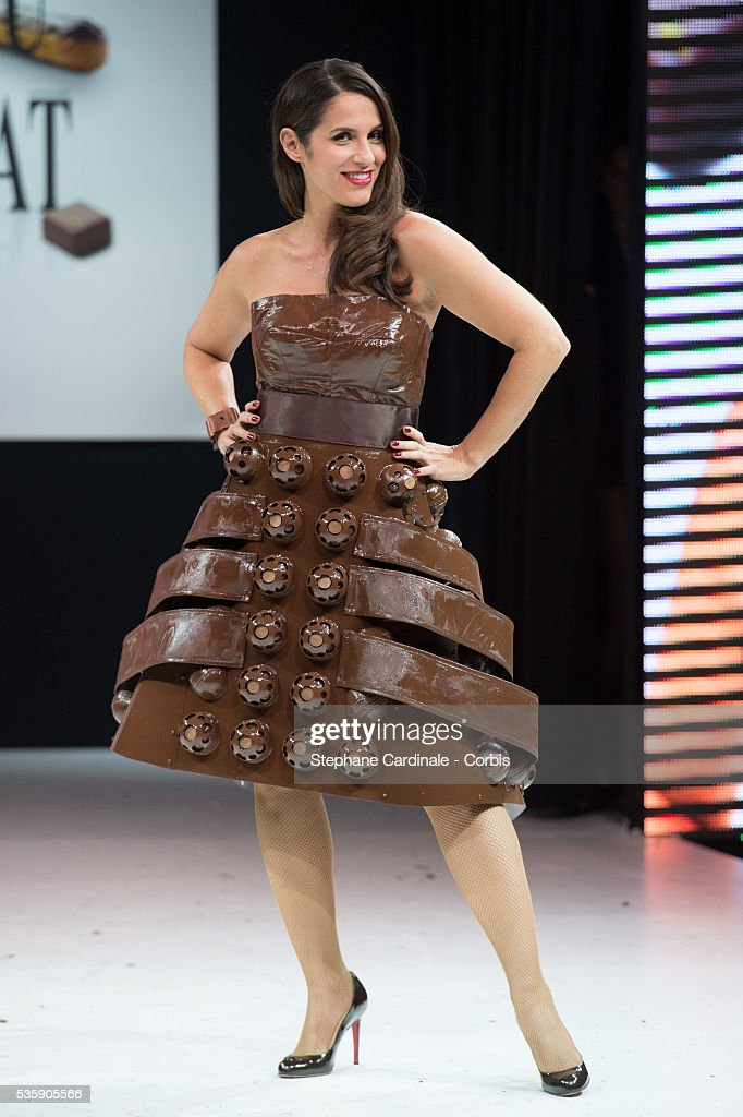 Singer and actress Elisa Tovati walks the runway and wears 'Gourmandise' a chocolate dress made by pastry maker Christelle Brua and Frederic Anton and designer Sonia Philippot during the Fashion Chocolate Show at Salon du Chocolat at Porte de Versailles, in Paris.