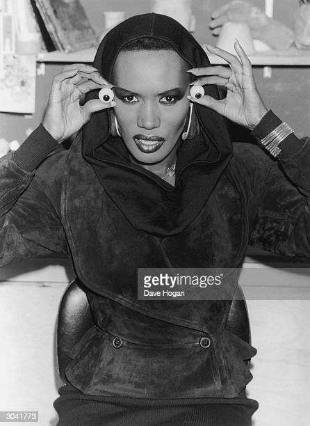 Singer and actress Grace Jones visits Madame Tussaud's to pose for a waxwork replica 25th February 1987