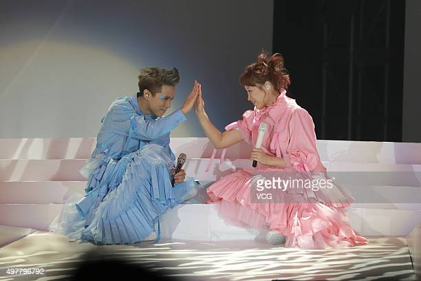 Singer and actress Ivana Wong singer Hins Cheung perform in the musical play Music Is Live on November 18 2015 in Hong Kong China