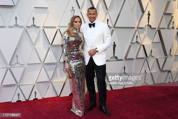 US singer and actress Jennifer Lopez and husband baseball player Alex Rodriguez arrive for the 91st Annual Academy Awards at the Dolby Theatre in...