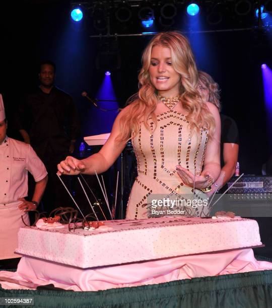 Singer and actress Jessica Simpson poses with a birthday cake at the grand opening of the Casino Club at The Greenbrier on July 2 2010 in White...