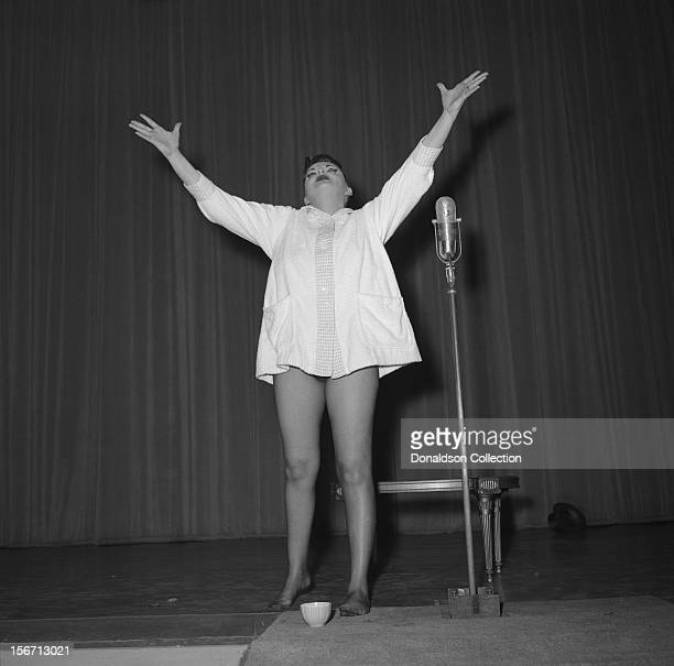 Singer and actress Judy Garland on stage during her opening night performance at the RKO Palace on September 26 1956 in New York City New York