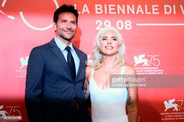 Singer and actress Lady Gaga and director and actor Bradley Cooper attend a photocall for the film 'A Star is Born' presented out of competition on...