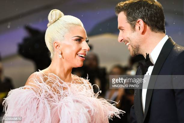 Singer and actress Lady Gaga and director and actor Bradley Cooper arrive for the premiere of the film A Star is Born presented out of competition on...