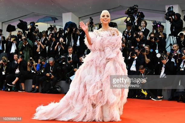 TOPSHOT Singer and actress Lady Gaga arrives for the premiere of the film A Star is Born presented out of competition on August 31 2018 during the...
