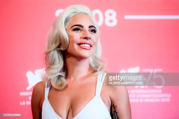 TOPSHOT Singer and actress Lady Gaga attends a photocall for the film A Star is Born presented out of competition on August 31 2018 during the 75th...