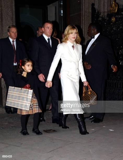 Singer and actress Madonna and her husband and film director Guy Ritchie arrive with their daughter Lourdes at the opening of the Mario Testino...