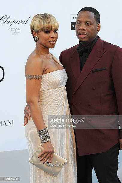 Singer and actress Mary J. Blige and Kendu Isaacs pose while arriving at amfAR's Cinema Against Aids 2010 benefit gala on May 20, 2010 in Antibes,...