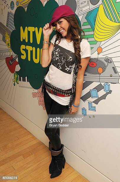Singer and actress Miley Cyrus poses backstage during MTV's TRL at MTV Studios on July 18 2008 in New York City
