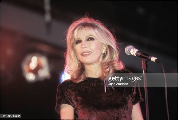 """Singer and actress Nancy Sinatra, the daughter Frank Sinatra, is shown performing on stage during a """"live"""" concert appearance on May 3, 1995."""
