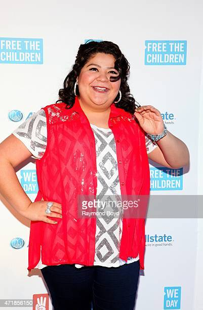 "Singer and actress Raini Rodriguez from the television show ""Austin & Ally"", poses for photos on the red carpet during ""We Day"" at the Allstate Arena..."
