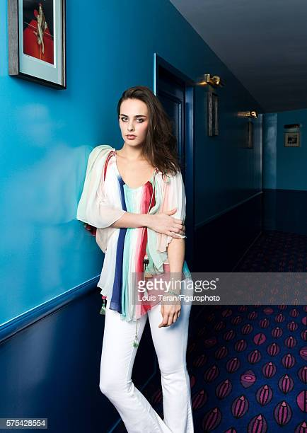 Singer and actress Sophie Auster is photographed for Madame Figaro on March 2 2016 at Hotel Le Grand Amour in Paris France Clothing bracelet shoes...