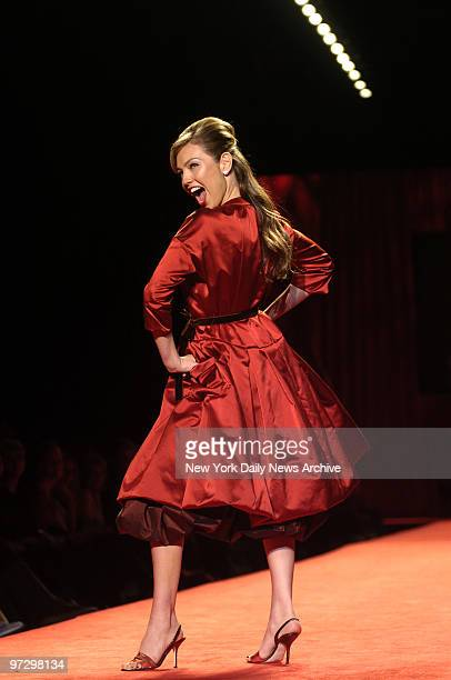 Singer and actress Thala struts the runway in a Vera Wang dress during the 2006 Heart Truth Red Dress Collection show at the Tent in Bryant Park on...